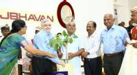 K.Narendran, farmer from Kollam presenting a Rudraksh sapling. to Governor at Kerala Raj Bhavan