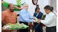 Governor gives away vegetable seed packets to staff .  Principal Secretary to Governor, Dr Davendrakumar Dhodawat receives  the first packet